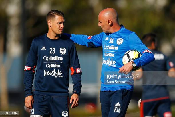 Kevin Muscat coach of the Victory speaks with Jai Ingham during a Melbourne Victory ALeague training session at Gosch's Paddock on February 2 2018 in...