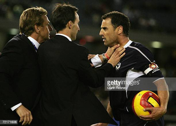 Kevin Muscat of the Victory clashes with United coach John Kosmina during the round eight Hyundai A-League match between the Melbourne Victory and...