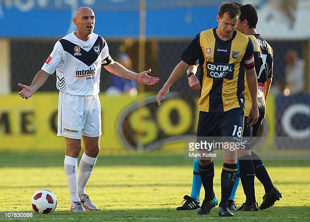 Kevin Muscat of the Victory exchanges words with Alex Wilkinson of the Mariners during the round 21 ALeague match between the Central Coast Mariners...