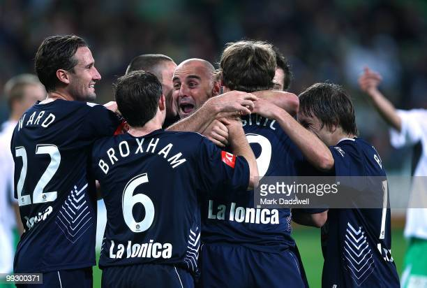 Kevin Muscat of the Victory is congratulated by teammates after setting up a penalty for Semir Sivic to score during the Kevin Muscat Testimonial...