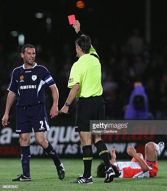 Kevin Muscat of the Victory is sent off by referee Mark Shield during the round eleven ALeague match between the Melbourne Victory and the Queensland...