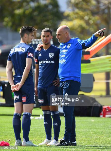 Kevin Muscat the coach of the Victory speaks to Nicholas Sette and Birkan Kirdar during a Melbourne Victory ALeague training session at Gosch's...