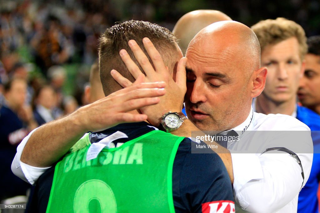 Kevin Muscat whispers into Besart Berisha of Melbourne Victory's ear after the round 26 A-League match between the Melbourne Victory and the Wellington Phoenix at AAMI Park on April 8, 2018 in Melbourne, Australia.