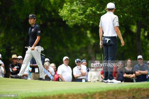 Kevin Na and Mackenzie Hughes of Canada read the second green during the final round of the Charles Schwab Challenge at Colonial Country Club on May...