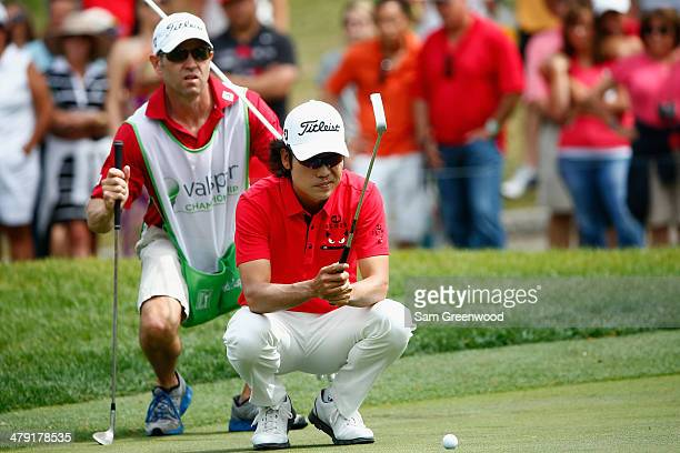 Kevin Na assesses a putt on the 4th green during the final round of the Valspar Championship at Innisbrook Resort and Golf Club on March 16 2014 in...