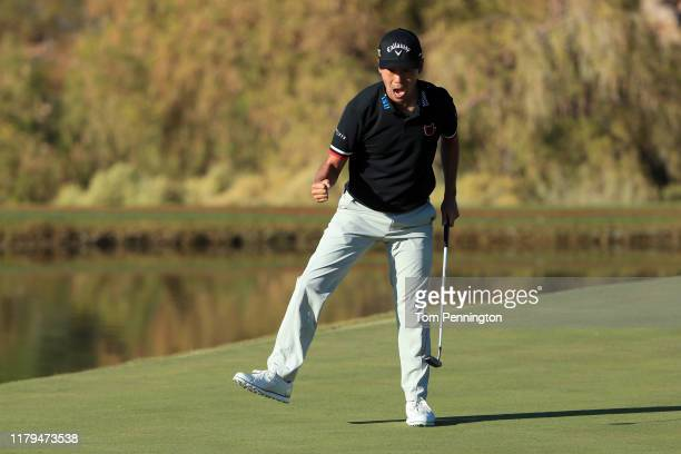 Kevin Na celebrates after making a putt on the 17th green during the final round of the Shriners Hospitals for Children Open at TPC Summerlin on...