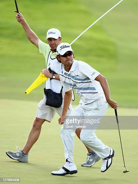 Kevin Na celebrates his birdie putt on the 17th green with his caddie Kenny Harms during the final round of the Justin Timberlake Shriners Hospitals...