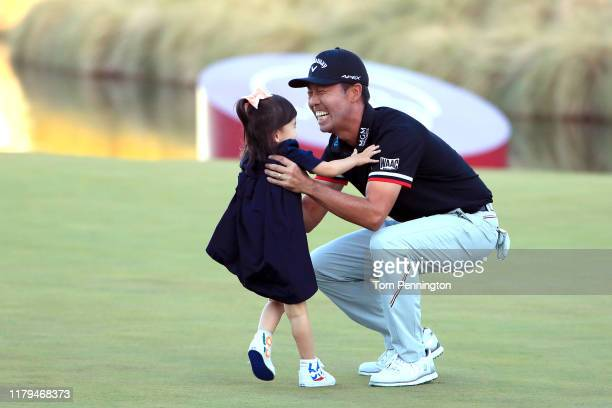 Kevin Na celebrates with his daughter Sophia Na after winning the Shriners Hospitals for Children Open on the second playoff hole during the final...