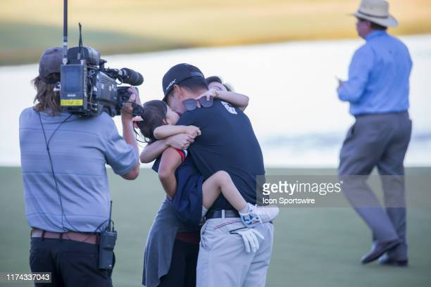 Kevin Na celebrates with his wife and daughter after becoming a two time winner of the Shriners Hospitals for Children Open after sinking his putt on...