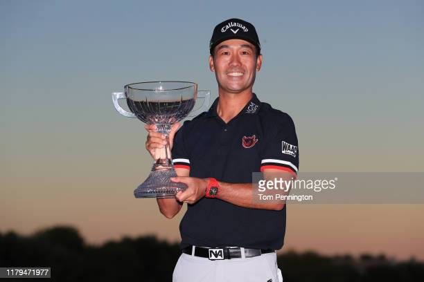 Kevin Na celebrates with the trophy after winning the Shriners Hospitals for Children Open on the second playoff hole during the final round at TPC...