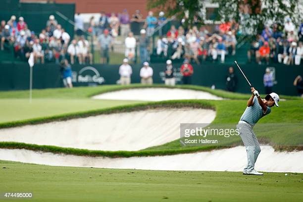 Kevin Na hits a shot from the 2th hole during the third round of the Crowne Plaza Invitational at the Colonial Country Club on May 23, 2015 in Fort...