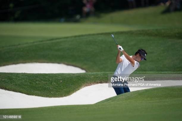 Kevin Na hits his second shot on the 12th hole during the second round of the 100th PGA Championship held at Bellerive Golf Club on August 10, 2018...