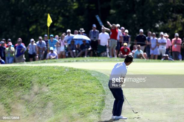 Kevin Na hits his third shot into the 12th hole during the final round of A Military Tribute At The Greenbrier held at the Old White TPC course on...
