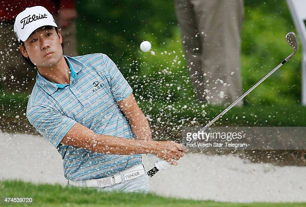 Kevin Na hits out of a bunker onto the 5th green during the third round of the Crowne Plaza Invitational at the Colonial in Fort Worth, Texas, on...