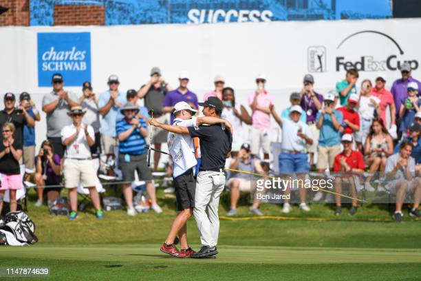 Kevin Na hugs his caddie on the eighteenth green during the final round of the Charles Schwab Challenge at Colonial Country Club on May 26 2019 in...