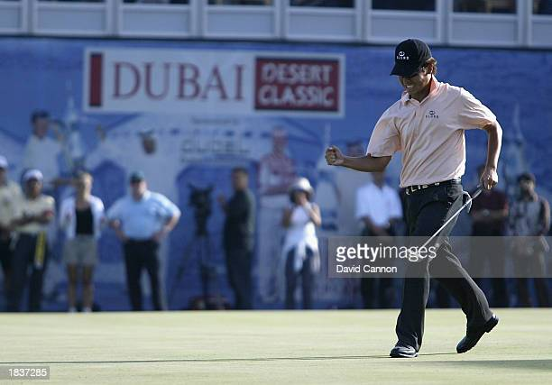 Kevin Na of Korea holes for birdie at 18th during the final round of the 2003 Dubai Desert Classic on the Majilis Course at the Emirates Golf Club in...