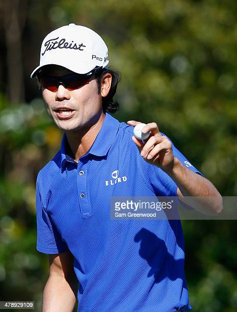 Kevin Na of South Korea acknowledges the gallery on the 11th green during the third round of the Valspar Championship at Innisbrook Resort and Golf...