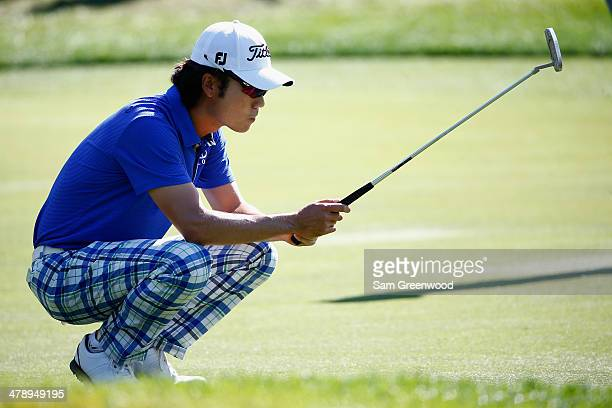 Kevin Na of South Korea assesses a putt on the 8th green during the third round of the Valspar Championship at Innisbrook Resort and Golf Club on...
