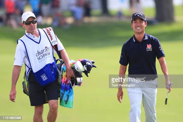Kevin Na of the United States and caddie Kenny Harms walk up the 18th fairway during the final round of the Charles Schwab Challenge at Colonial...