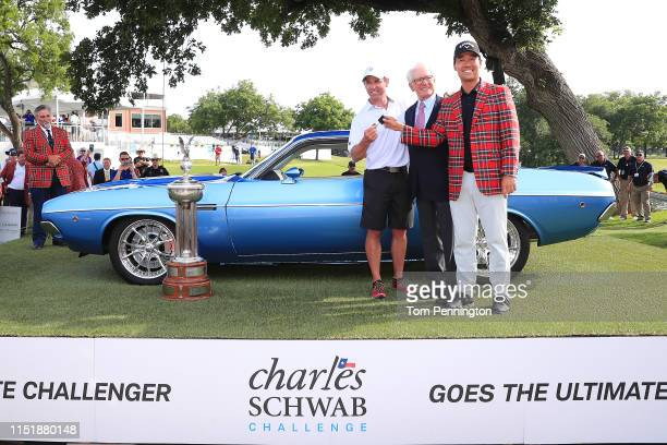 Kevin Na of the United States and his caddie, Kenny Harms , pose for a photo with Charles Schwab after being presented with the keys to a fully...