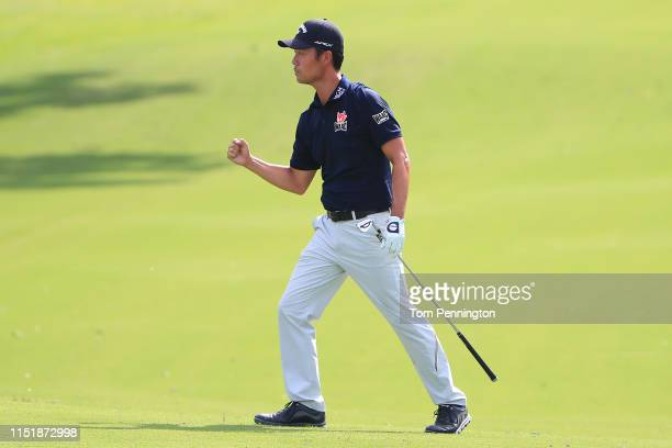 Kevin Na of the United States celebrates after playing his shot from the 18th fairway during the final round of the Charles Schwab Challenge at...