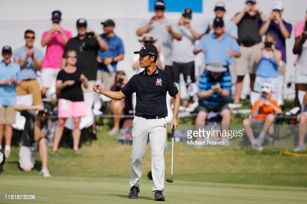 Kevin Na of the United States celebrates on the 18th green after making a putt to win the Charles Schwab Challenge at Colonial Country Club on May 26...