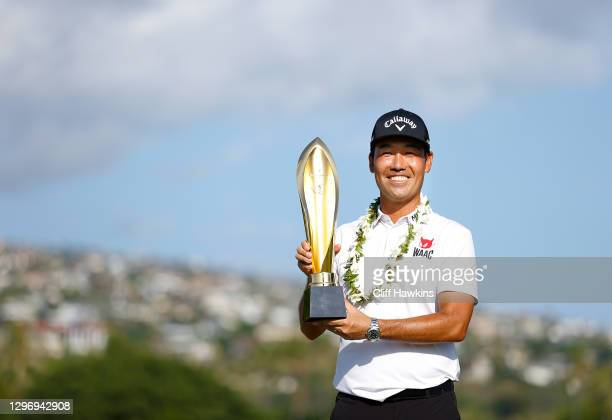 Kevin Na of the United States celebrates with the trophy after winning the Sony Open in Hawaii at the Waialae Country Club on January 17, 2021 in...