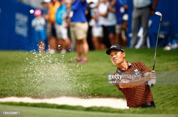 Kevin Na of the United States plays a shot from a bunker on the 18th hole during a six-way sudden-death playoff during the final round of the Wyndham...