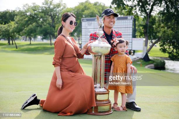 Kevin Na of the United States poses for a photo with his wife Jullianne Na and daughter Sophie Na after winning the 2019 Charles Schwab Challenge at...