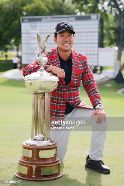 Kevin Na of the United States poses for a photo with the trophy after winning the Charles Schwab Challenge at Colonial Country Club on May 26 2019 in...