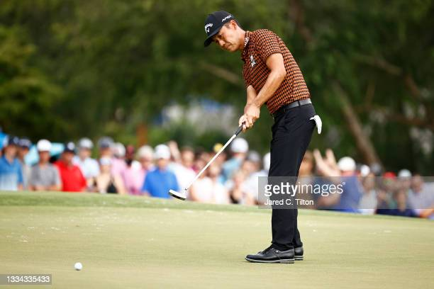 Kevin Na of the United States putts putts on the 18th green during the final round of the Wyndham Championship at Sedgefield Country Club on August...