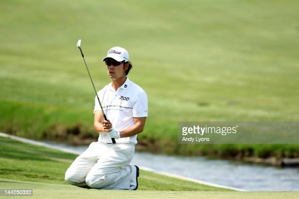 Kevin Na of the United States reacts to a missed chip for birdie on the fourth hole during the third round of THE PLAYERS Championship held at THE...