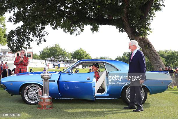 Kevin Na of the United States talks with Charles Schwab after being presented with a fully restored 1973 Dodge Challenger for winning the 2019...