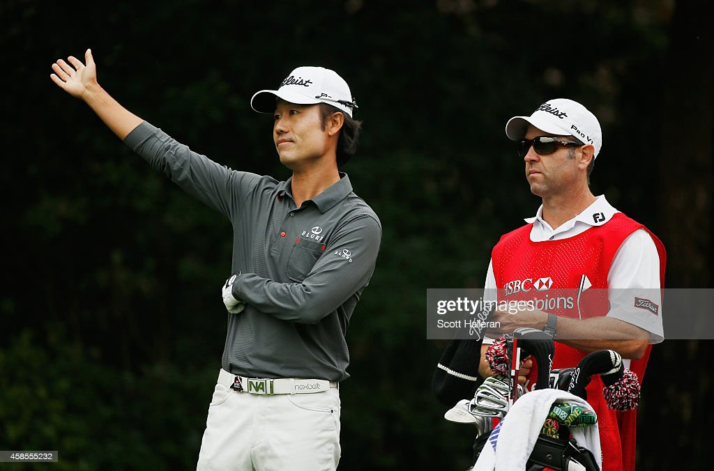 Kevin Na of the United States waits on the 16th hole with his caddie Kenny Harms during the second round of the WGC - HSBC Champions at the Sheshan International Golf Club on November 7, 2014 in Shanghai, China.