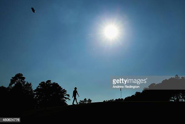 Kevin Na of the United States walks across the 14th green during the third round of the 114th US Open at Pinehurst Resort Country Club Course No 2 on...
