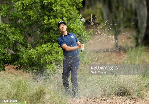 Kevin Na pf the United States plays his third shot on the par 5, second hole during the third round of the 2019 Players Championship held on the...