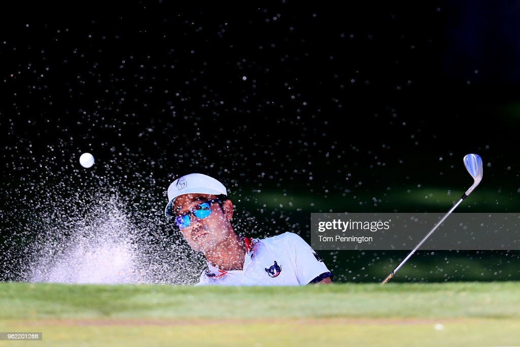 Kevin Na plays a shot from a bunker on the eighth hole during round one of the Fort Worth Invitational at Colonial Country Club on May 24, 2018 in Fort Worth, Texas.