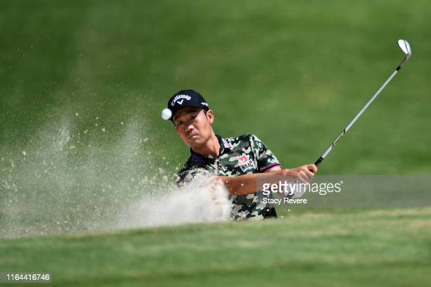 Kevin Na plays a shot from a bunker on the first hole during the second round of the World Golf Championship-FedEx St Jude Invitational on July 26,...