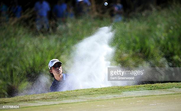 Kevin Na plays a shot from a bunker on the seventh hole during round three of THE PLAYERS Championship at the TPC Sawgrass Stadium course on May 9,...