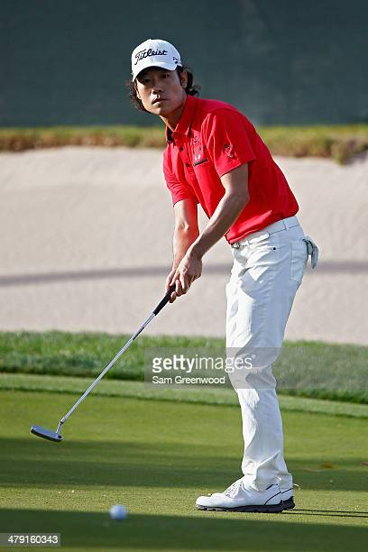 Kevin Na putts on the 18th green during the final round of the Valspar Championship at Innisbrook Resort and Golf Club on March 16, 2014 in Palm...