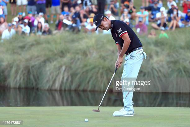 Kevin Na putts to win the Shriners Hospitals for Children Open on the second playoff hole during the final round at TPC Summerlin on October 6 2019...
