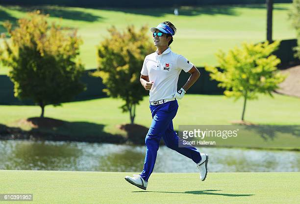 Kevin Na runs on the 18th hole during the final round of the TOUR Championship at East Lake Golf Club on September 25 2016 in Atlanta Georgia