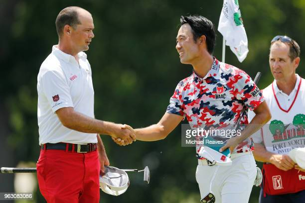 Kevin Na shakes hands with Tyrone Van Aswegen of South Africa after completeing their final round of the Fort Worth Invitational at Colonial Country...