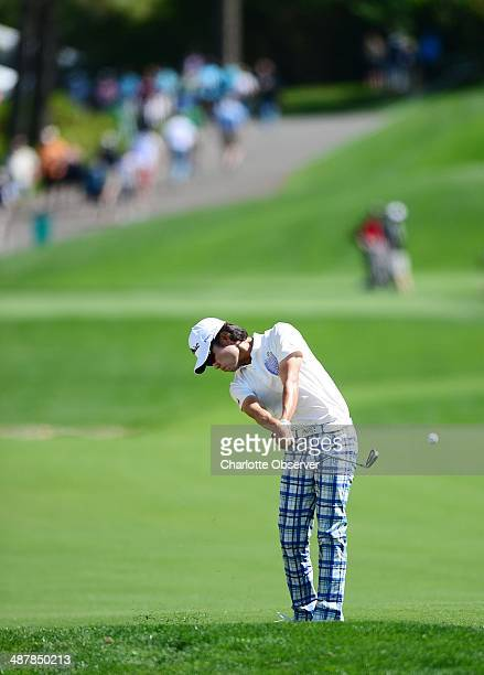 Kevin Na strikes the ball in the 18th fairway during the second day of competition at the Wells Fargo Championship at Quail Hollow Club in Charlotte,...