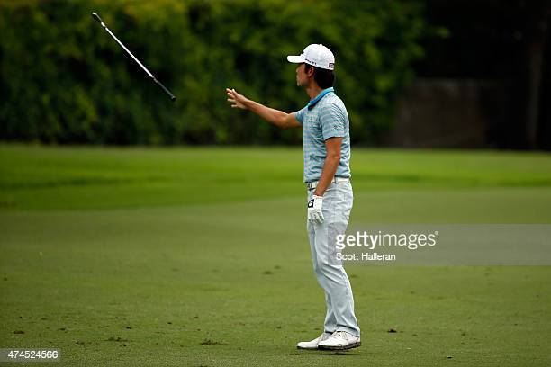 Kevin Na tosses his club after his shot on the 15th fairway during the third round of the Crowne Plaza Invitational at the Colonial Country Club on...
