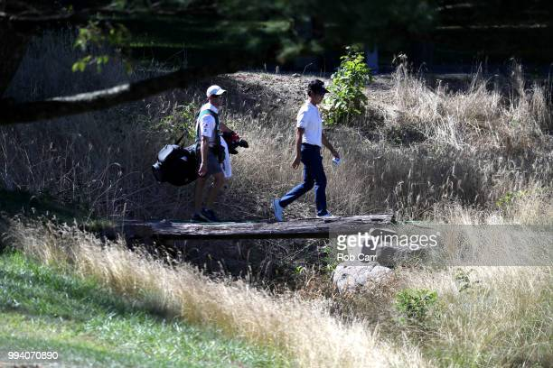 Kevin Na walks to the 13th tee during the final round of A Military Tribute At The Greenbrier held at the Old White TPC course on July 8 2018 in...