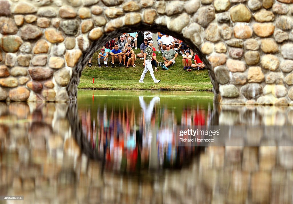 Kevin Na walks to the third green during the third round of the World Golf Championships - Bridgestone Invitational at Firestone Country Club South Course on August 8, 2015 in Akron, Ohio.