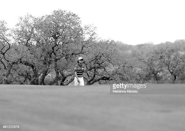 Kevin Na walks up the 18th fairway during Round Two of the Valero Texas Open at TPC San Antonio ATT Oaks Courseon March 28 2014 in San Antonio Texas