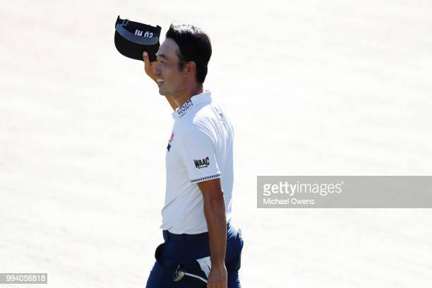 Kevin Na waves to spectators just before winning the tournament on the 18th green during the final round of A Military Tribute At The Greenbrier held...