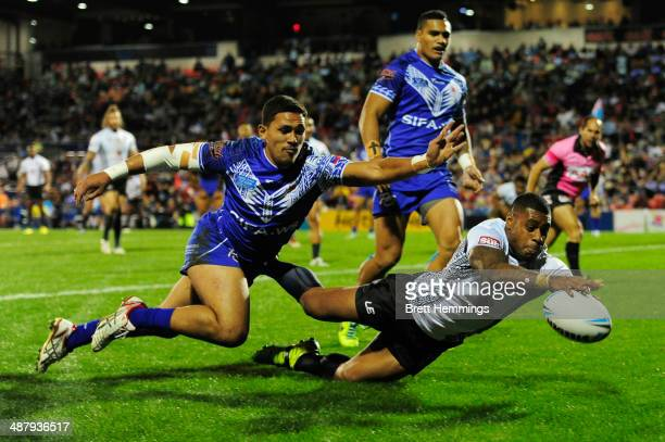 Kevin Naiqama of Fiji dives on the ball to score during the International Test Match between Fiji and Samoa at Sportingbet Stadium on May 3 2014 in...